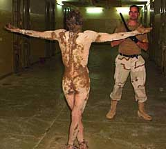 a534_abu_ghraib_detainee_covered_in_feces_fredrick_with_stick_2050081722-7799